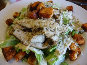 Saguaro Cafe Caesar Salad topped with grilled Chicken Breast